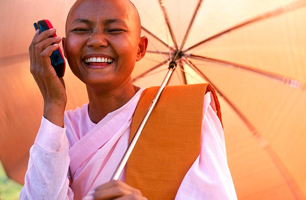 Nun with mobile, Myanmar (Burma)