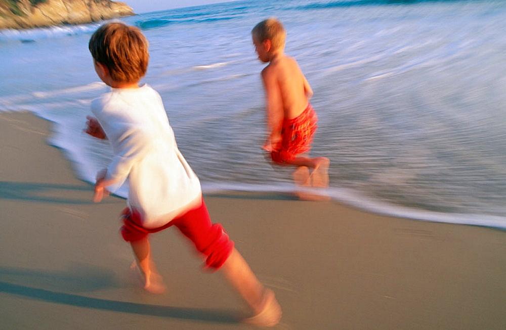 Friends running at the beach