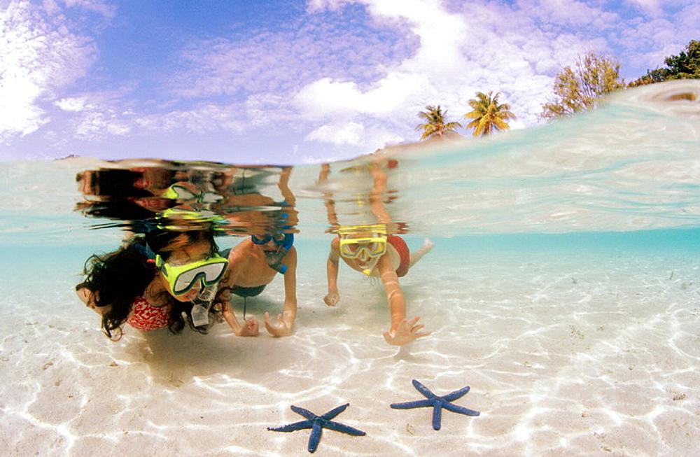 Children at the beach, Honeymoon Island, Florida, USA.
