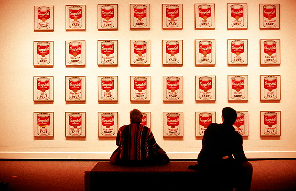 Two people looking at Campbell's Soup cans, National Gallery of Art, East Building, Washington D.C.