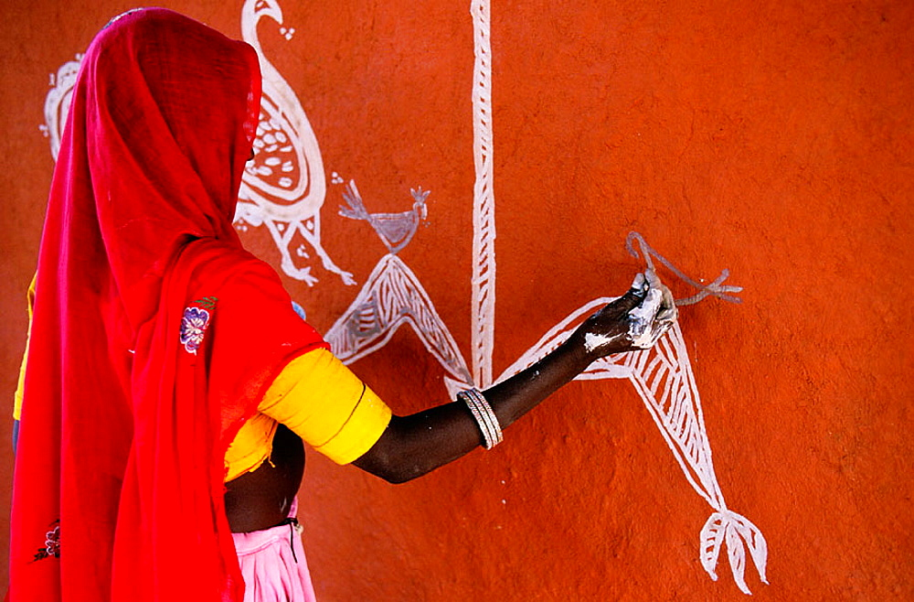 Woman painting a wall, Tonk area, Rajasthan, India