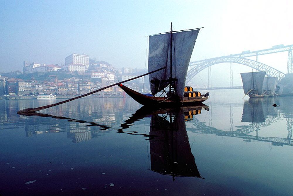 Old sailboats carrying barrels of Porto wine on Douro River, Porto, Portugal