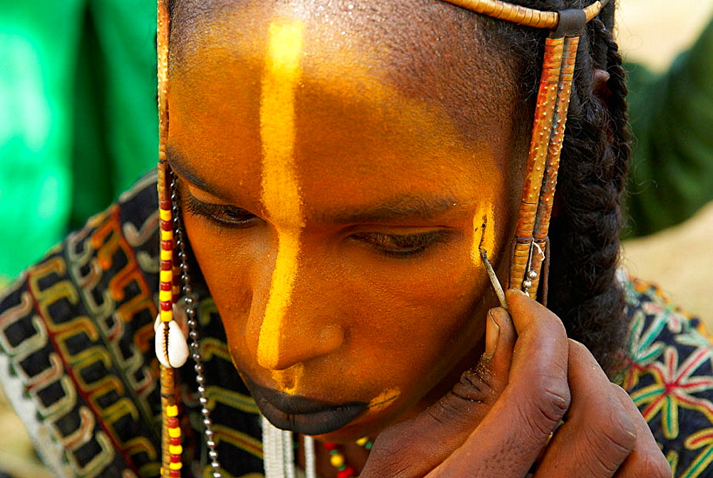 Niger, A Wodaabe-Bororo man with his face painted for the annual Gerewol male beauty contest