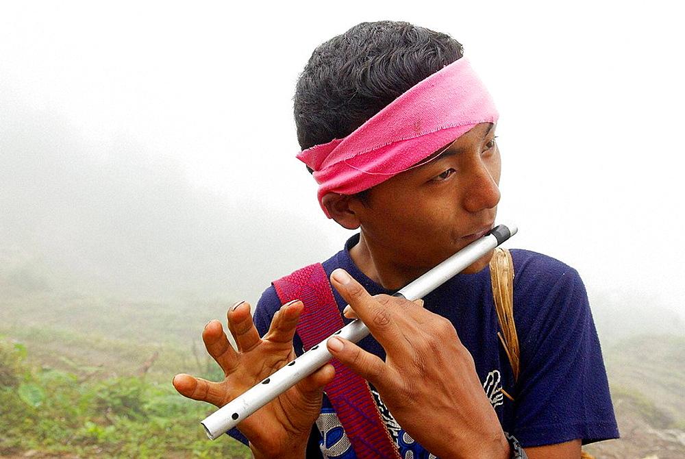 Nepal, Arun valley, East Nepal, Flute player.