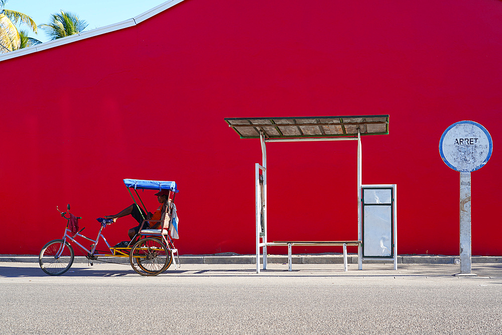 Taxi Brousse Bus stop and a cyclo-pousse in Morondava, Western Madagascar, Africa