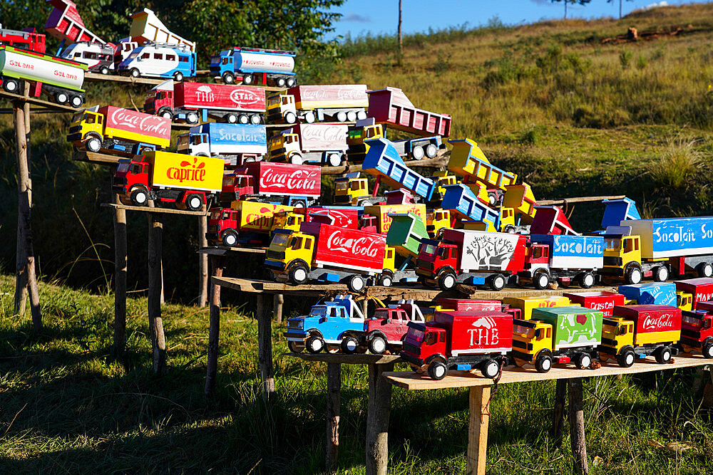 Replica trucks and lorries for sale at a roadside stall on the RN7 near Antsirabe, Central Madagascar