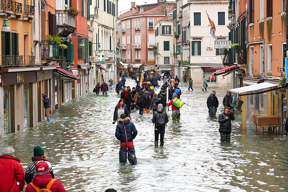 High tide in Venice in November 2019, people walking in Rio Tera San Leonardo, Venice, UNESCO World Heritage Site, Veneto, Italy, Europe