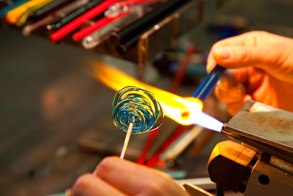 Student making a glass bead, Abate Zanetti glass school, Murano island, Venice, Veneto, Italy, Europe