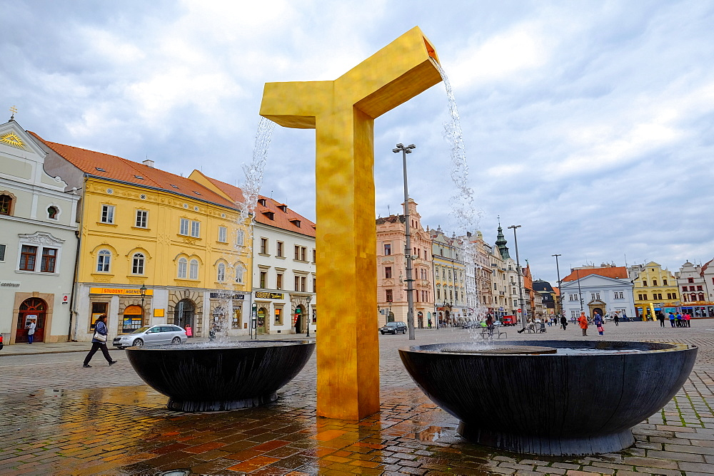 One of the three modern gold fountains in the Republic Square, Pilsen (Plzen), West Bohemia, Czech Republic, Europe