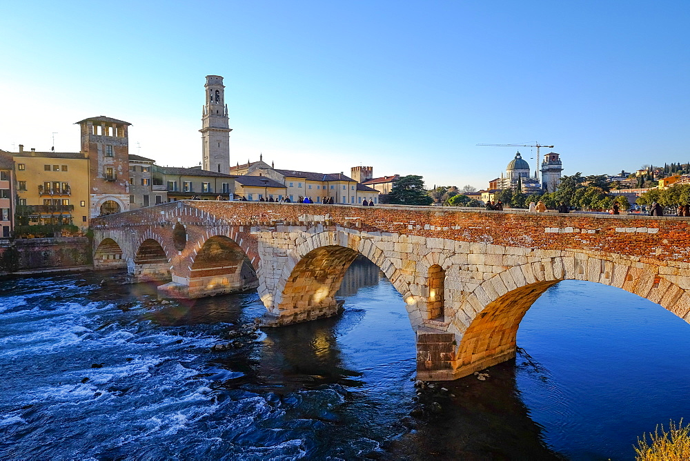 The Ponte Pietra, a Roman arch bridge crossing the Adige River in Verona, Veneto, Italy, Europe