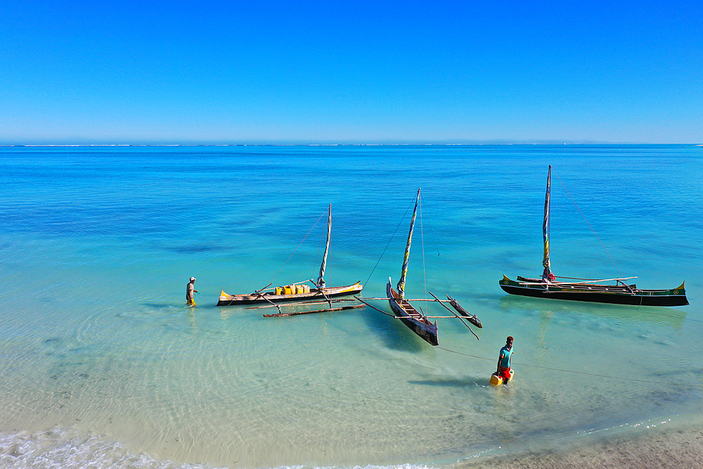 Outrigger boats on the coral reef near Salary, South Western coast of Madagascar, Indian Ocean, Africa