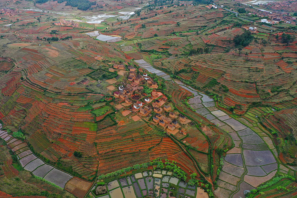 Rice fields and small villages near Ivato, Ambositra district, National Route RN7 between Ranomafana and Antsirabe, Madagascar, Africa