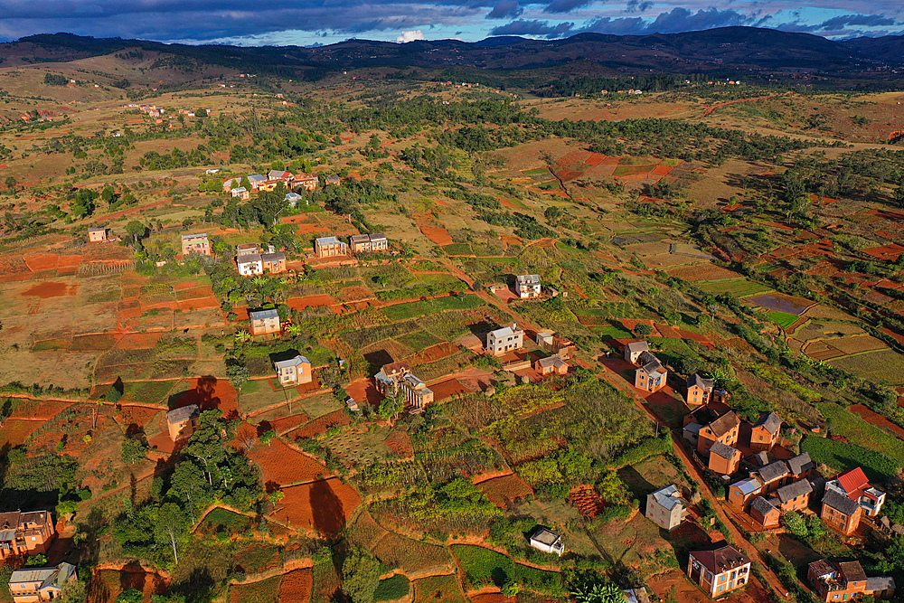 Rice fields and small mud villages near Sandrandahy, on the National Route RN7 between Ranomafana and Antsirabe, Madagascar, Africa
