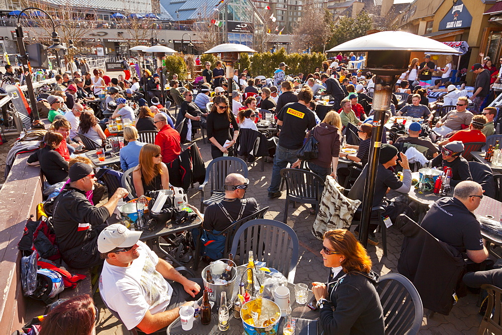 Visitors enjoying apres ski at an outdoor patio, Whistler Blackcomb Ski Resort, Whistler, British Columbia, Canada, North America - 821-147