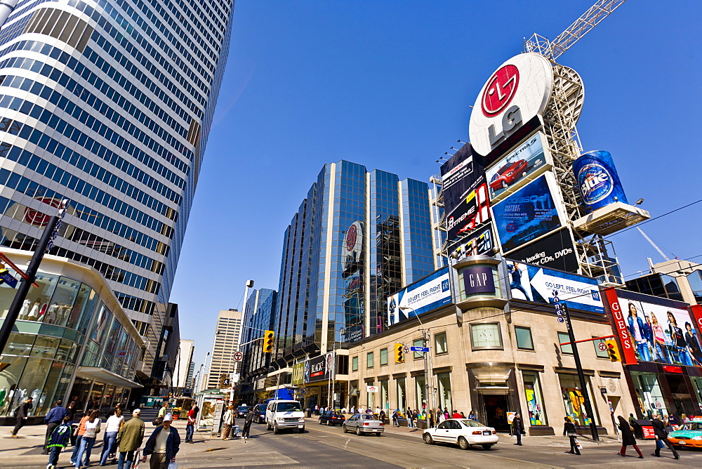 Intersection of Young Street and Dundas Street, showing part of Eaton Center, as viewed from Dundas Square, Toronto, Ontario, Canada, North America - 821-171