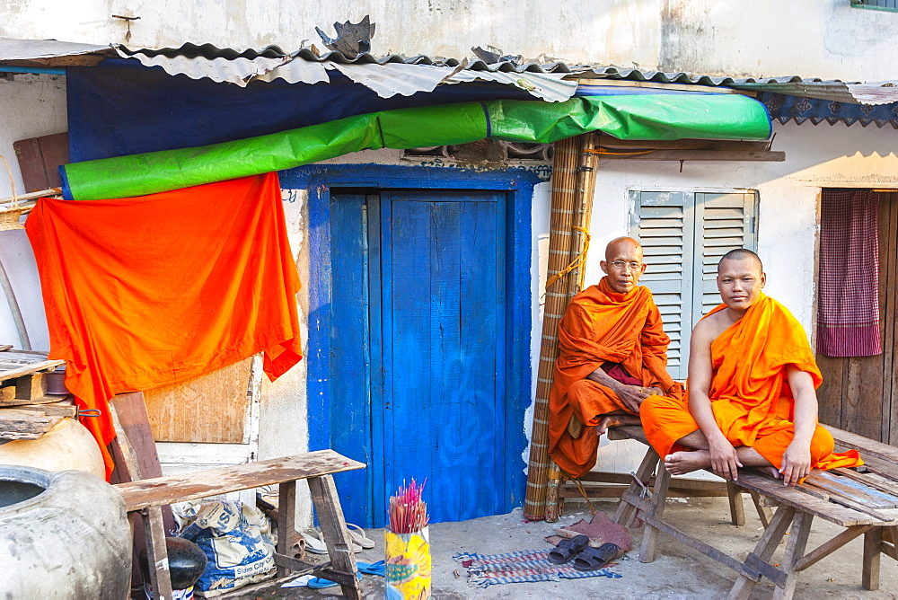 Buddhist monks by blue door, Phnom Penh, Cambodia, Indochina, Southeast Asia, Asia - 821-220