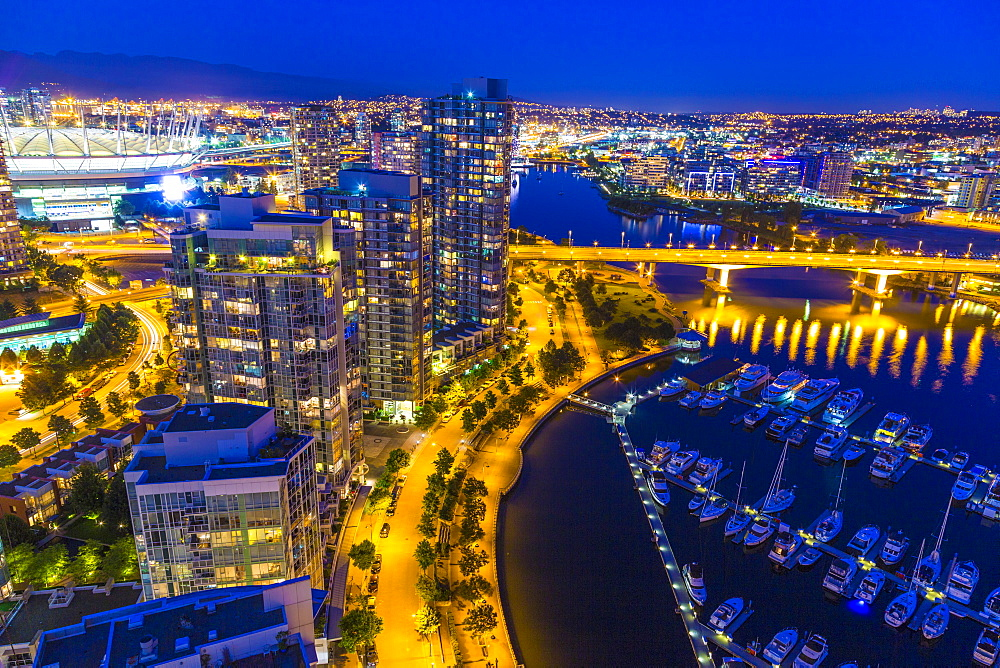 Aerial view, at twilight, showing Yaletown, downtown, False Creek, Cambie Street Bridge, Vancouver, British Columbia, Canada, North America - 821-256