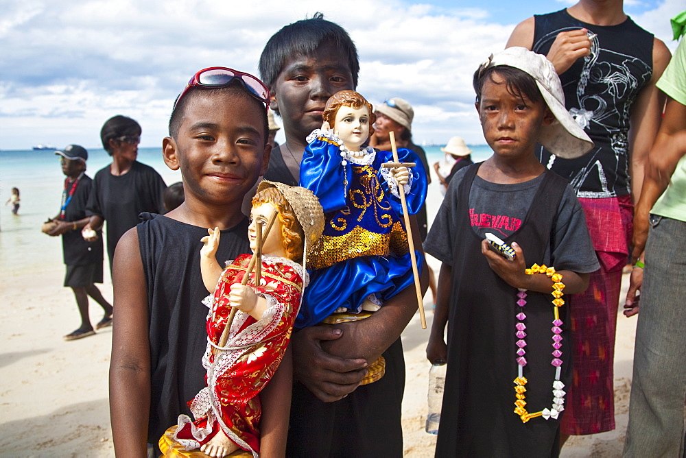 Boys, with soot smeared on their faces, in the parade along White Beach during the Ati-Atihan Festival, an annual feast in honour of the Santo Nino, Boracay, Aklan, Philippines, Southeast Asia, Asia