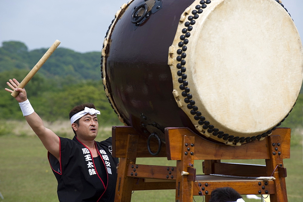 Drummer performing on a Japanese taiko drum at a festival in Kanagawa, Japan, Asia