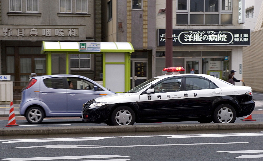 A police car from Shizuoka Prefecture speeding past, Tokyo, Japan, Asia