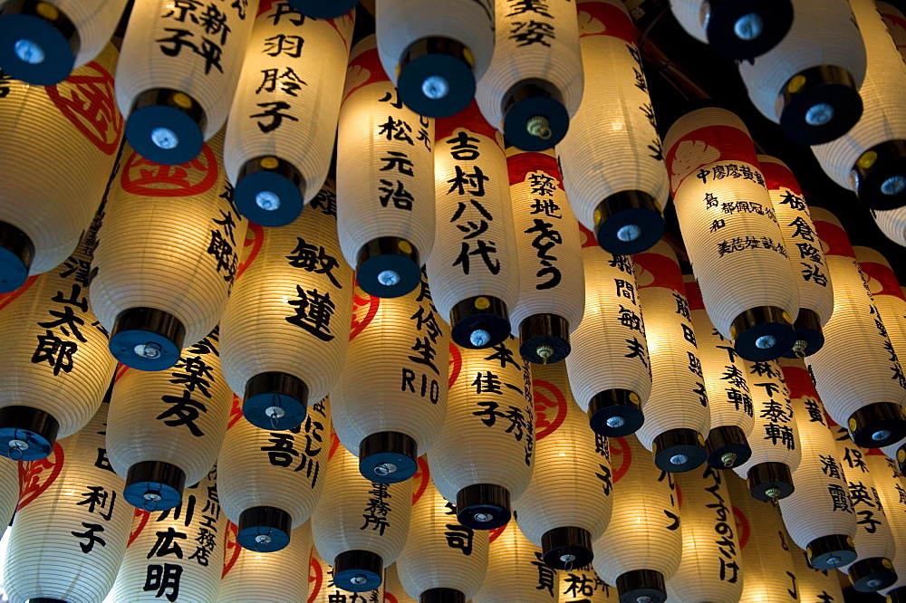 Lanterns with donors names hanging from the ceiling at Hozenji Temple in Namba, Osaka, Japan - 822-208