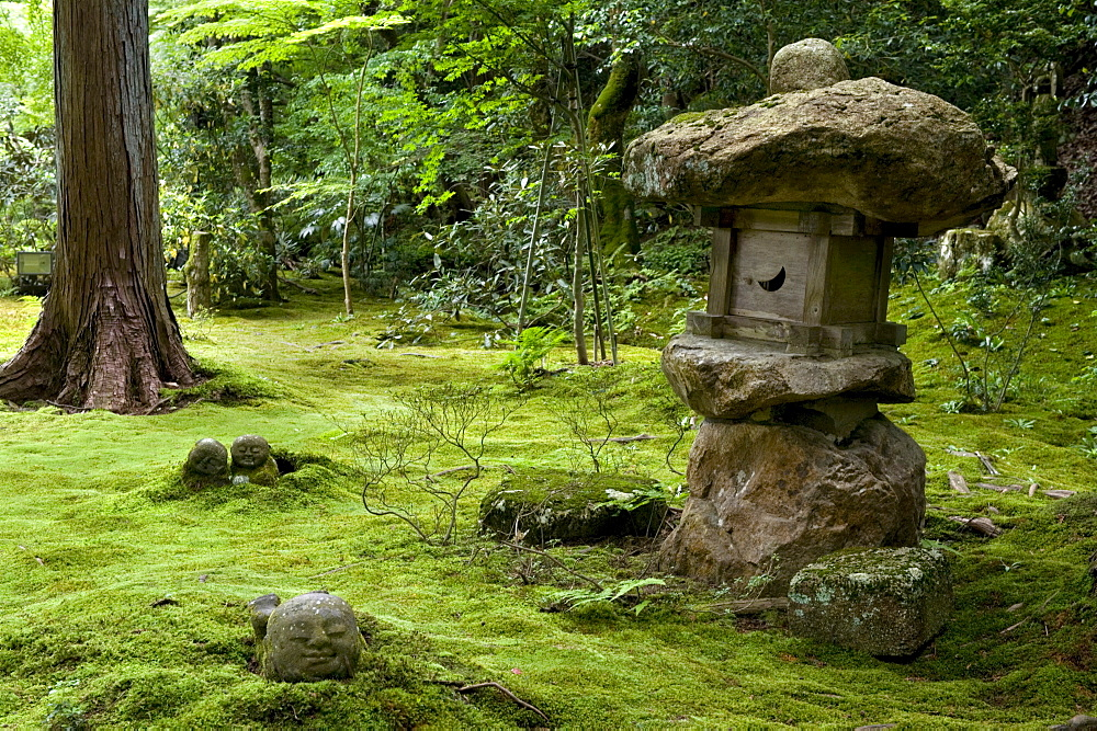 A rugged stone lantern accents a moss garden at Sanzenin Temple in Ohara, Kyoto, Japan, Asia - 822-226