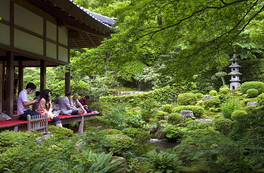 Visitors relaxing at a Zen meditation garden at Sanzenin Temple in Ohara, Kyoto, Japan, Asia - 822-227