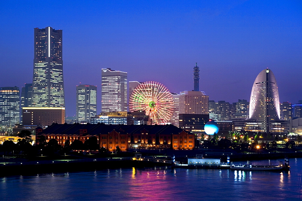 Twilight view of Red Brick Park and Landmark Tower at MM21 waterfront complex, Yokohama, Japan, Asia - 822-234