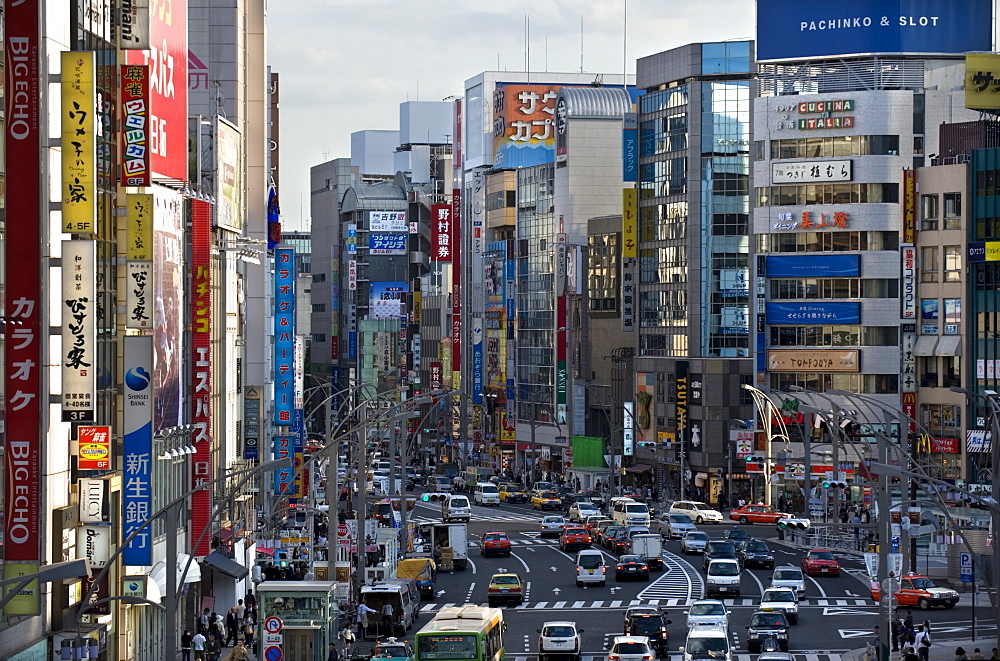 Tall buildings, signs and traffic create the urban canyon of Chuo-dori Street in the Ueno district of Tokyo, Japan, Asia - 822-245