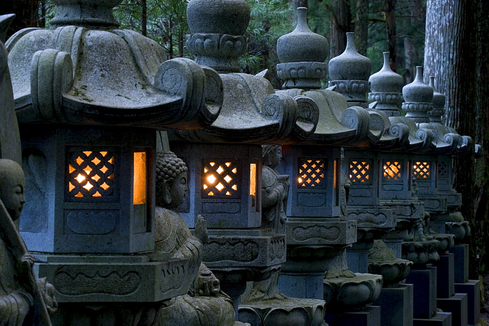 Row of lighted stone lanterns in the Okunoin Temple cemetery at Koyasan (Mount Koya), Wakayama, Japan, Asia - 822-256