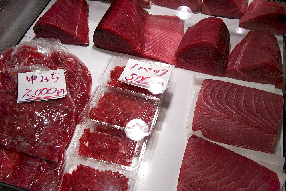 Raw maguro (tuna sashimi) for sale at Tsukiji Wholesale Fish Market, the world's largest fish market in Tokyo, Japan, Asia - 822-268