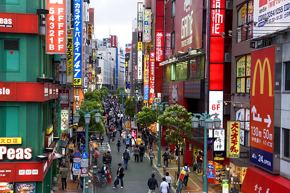 A pedestrian street lined with shops and signboards attracts a crowd in Shinjuku, Tokyo, Japan, Asia - 822-282