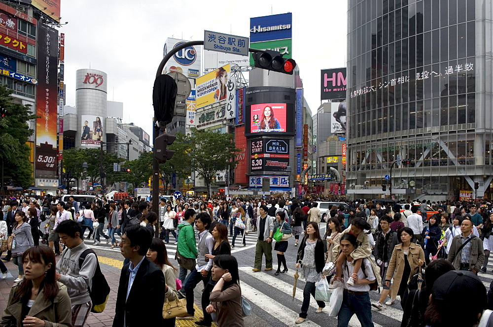 Shibuya crossing in front of the Shibuya train station is one of Tokyo's busiest city centers, Tokyo, Japan, Asia - 822-283