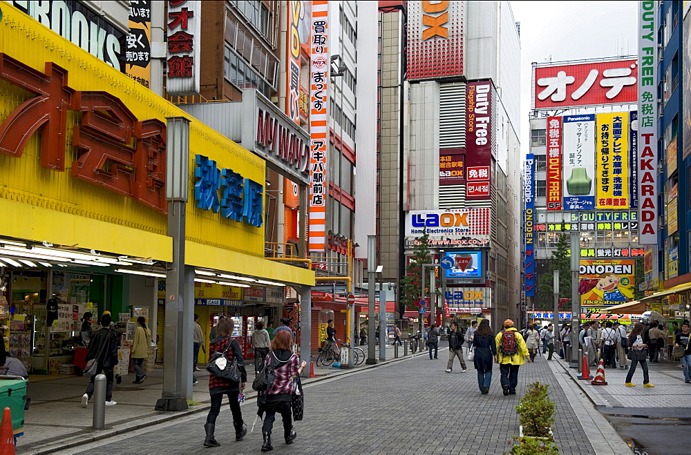 Neon signs cover buildings in the world famous consumer electronics district of Akihabara, Tokyo, Japan, Asia - 822-286