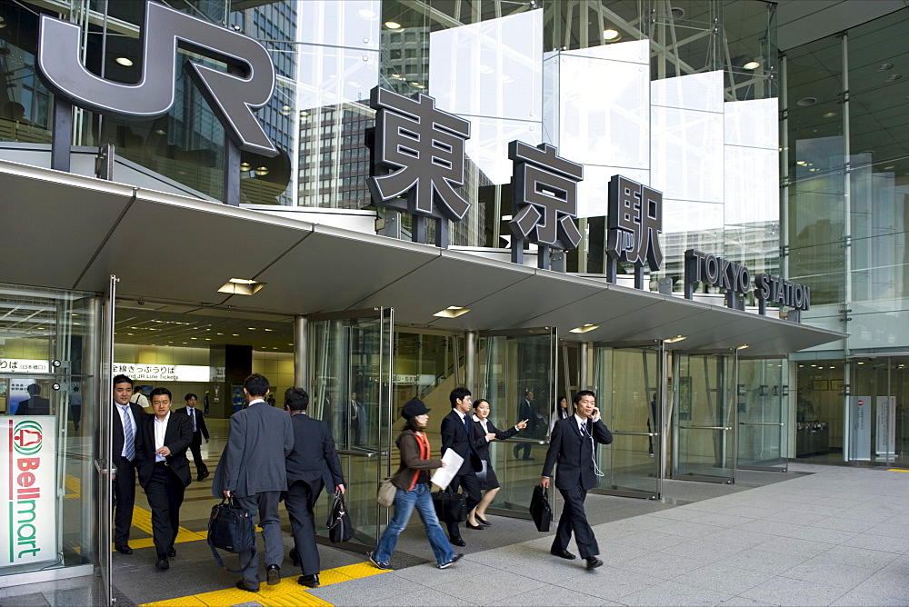 Business people at the contemporary glass entrance on the Otemachi side of Tokyo Station, Japan, Asia - 822-304