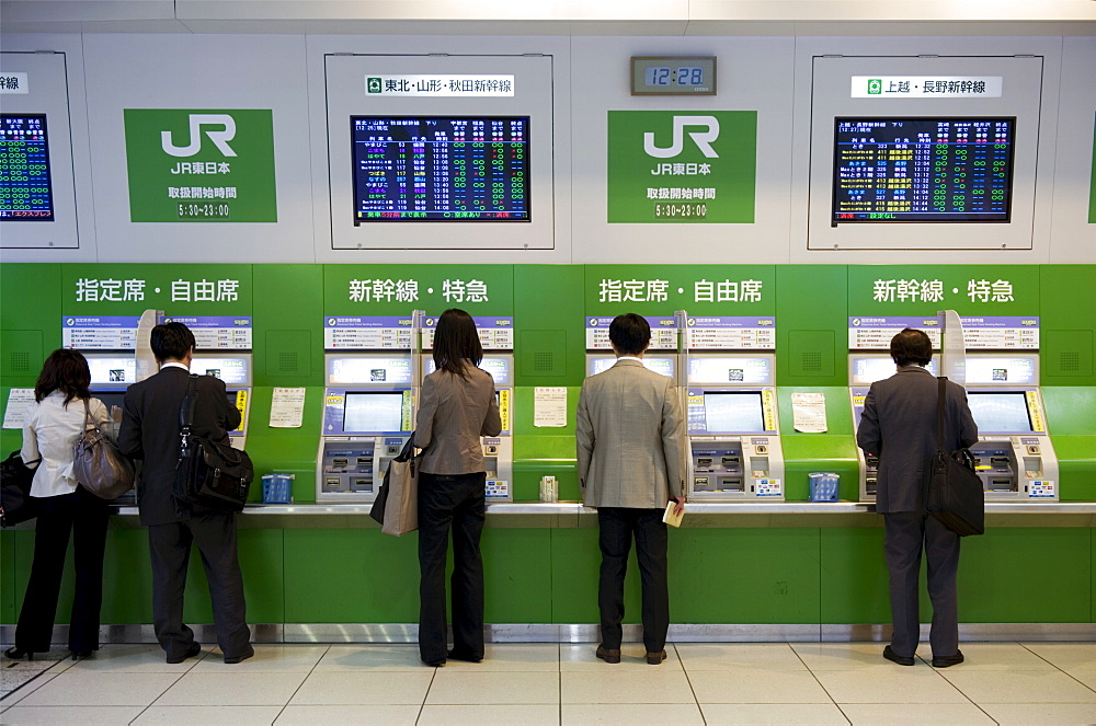 Passengers purchasing bullet train tickets from vending machines at the central JR (Japan Railway) station in Tokyo, Japan, Asia - 822-305