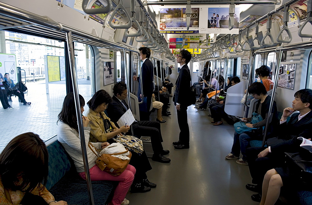 Passengers riding aboard the Yamanote loop line train that encircles greater metropolitan Tokyo, Japan, Asia - 822-307