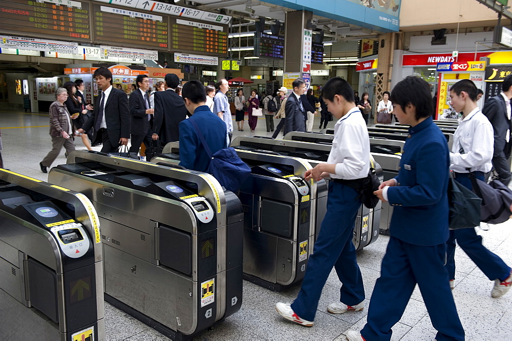 Passengers passing through automatic ticket wickets upon entering the JR Ueno railway station in Tokyo, Japan, Asia - 822-309