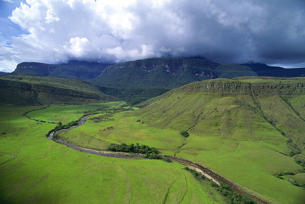 Aerial image of tepuis showing south side of Auyantepui (Auyantepuy) (Devil's Mountain) from Uruyen valley, Canaima National Park, UNESCO World Heritage Site, Venezuela, South America