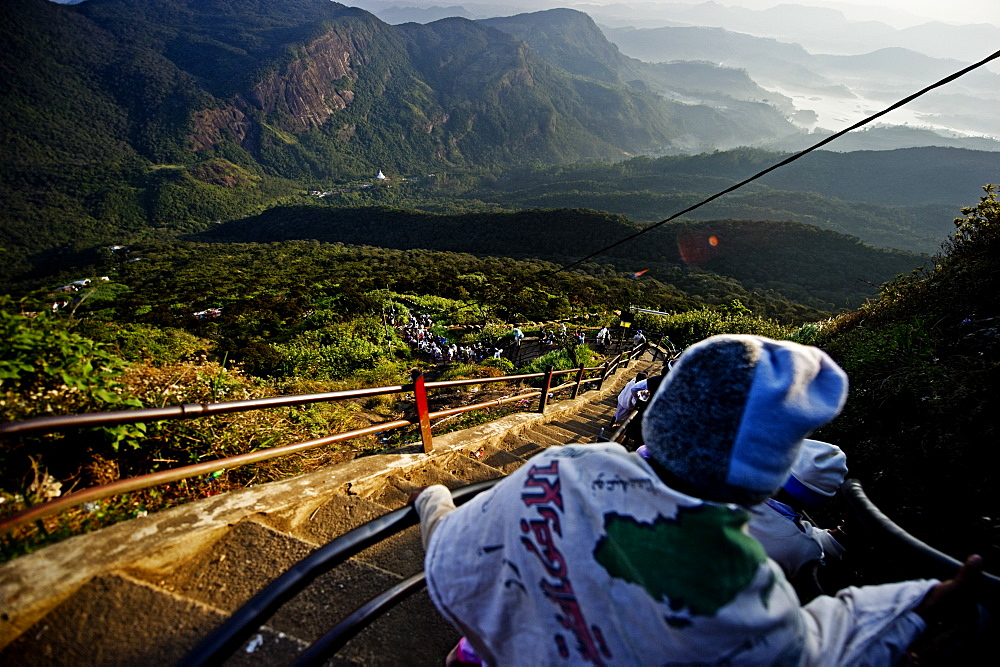 Pilgrims descending Sri Pada (Adam's Peak) in the morning sunlight, Sri Lanka, Asia  - 824-135