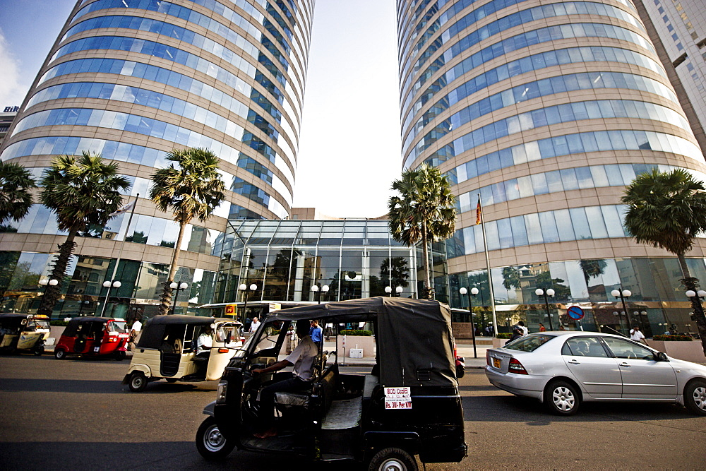 A tuk tuk in front of the World Trade Centre, Colombo, Sri Lanka, Asia