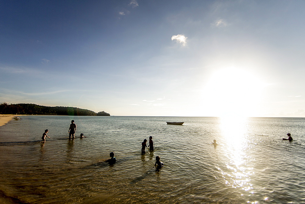Children play on Simpang Mengayau beach, an emerging eco tourism destination in the Tun Mustapha Park, Malaysian Borneo, Malaysia, Southeast Asia, Asia  - 824-158
