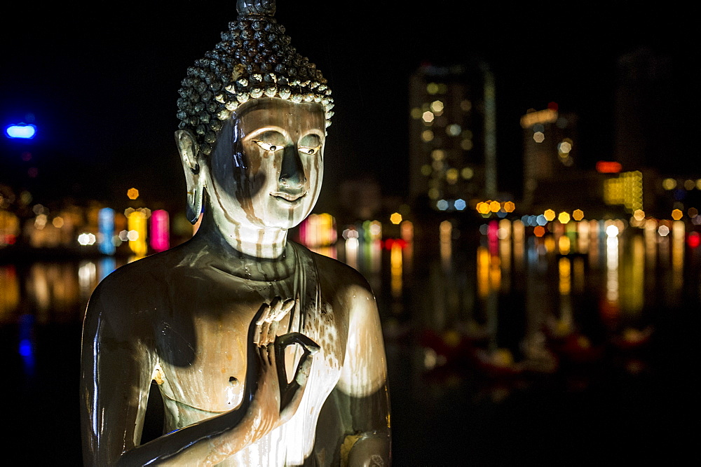 A statue of Buddha at Vesak, a festival to celebrate Buddha's birthday in Gangaramaya Temple, Colombo, Sri Lanka, Asia