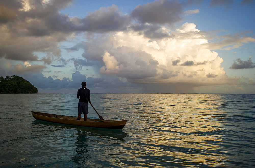 A man in a dug out canoe, Solomon Islands, Pacific