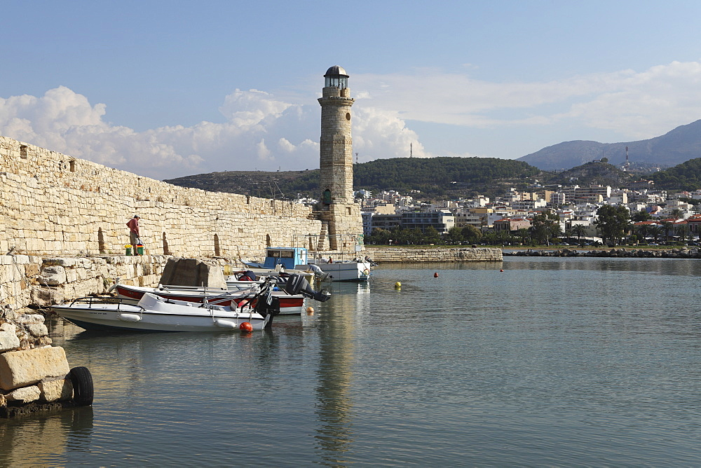 The Venetian era harbour walls and lighthouse at the Mediterranean port of Rethymnon, Crete, Greek Islands, Greece, Europe