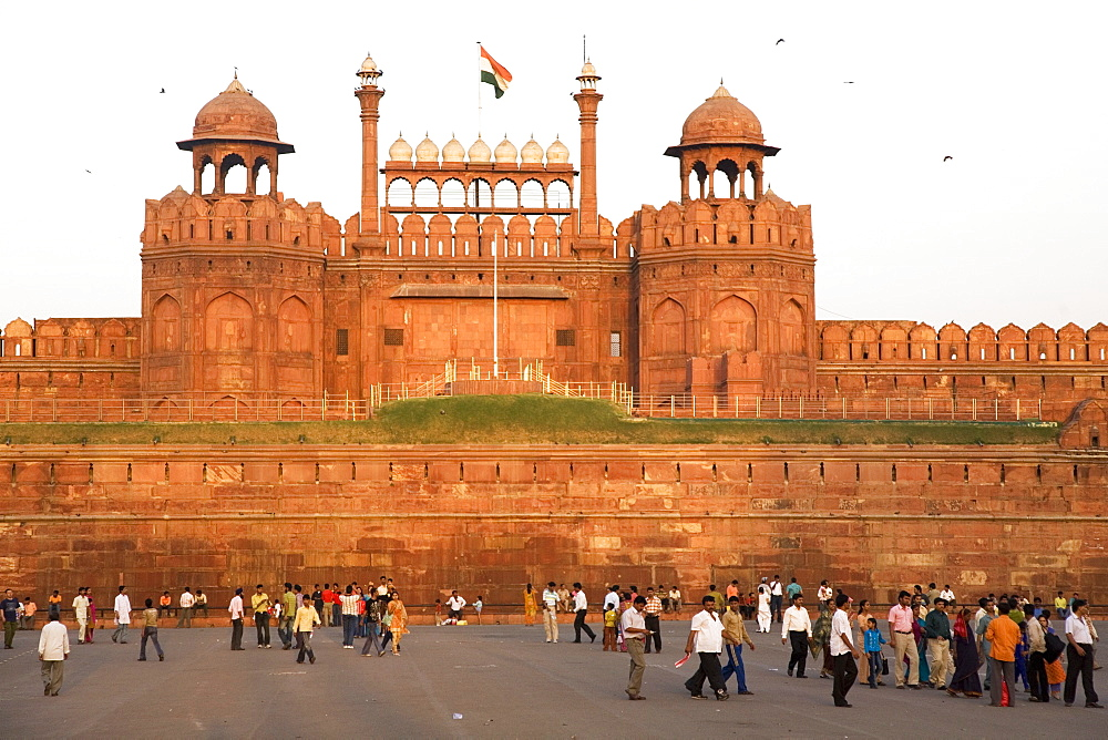 People enjoy an evening walk outside of the Red Fort (Lal Qila), built by Shah Jahan between 1638 and 1648, UNESCO World Heritage Site, Delhi, India, Asia