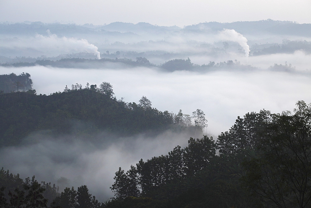 Early morning mist and smoke from brickworks in the valley over the jungle of Bandarban, Chittagong Division, Bangladesh, Asia - 826-592