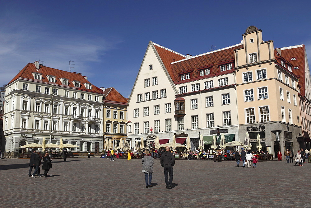 Town Hall Square, surrounded by grand, historic buildings, many now used as bars and cafes, in Tallinn, Estonia, Europe