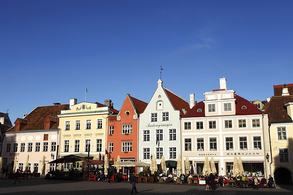 Town Hall Square, surrounded by grand, historic buildings, many now used as bars and cafes, in Tallinn, Estonia, Europe - 826-604