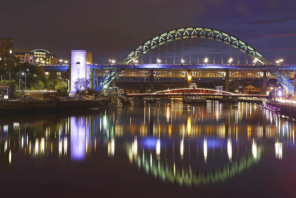 The Tyne Bridge spans the River Tyne, above the Swing Bridge, between Gateshead and Newcastle-upon-Tyne, Tyneside, England, United Kingdom, Europe